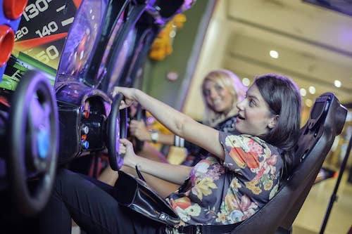 girl playing arcade